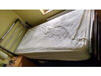 Chrome headboard, steel frame, wooden slatted single bed