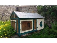 Rabbit Hutch with bedding and accessories .