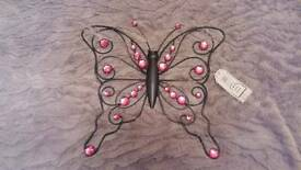 Metal butterfly with pink jewels