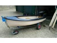 Small 2 man fishing boat with outboard