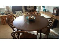 Solid dark oak dining table and chairs