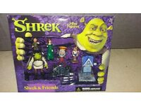 Shrek mini figures in original boxes, never been opened. Collectibles.