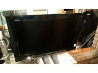 Sharp 24' Tv with stand and remote