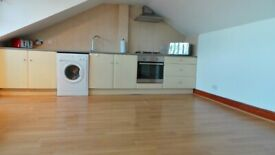 Prime Location Immaculate condition 2 bedrooms first floor maisonette with Driveway