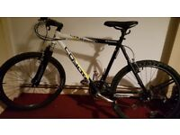 """Coyote 26"""" wheels front suspension mountain bike."""