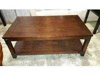 Nearly new, dark wooden coffee table