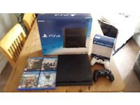 Boxed PS4 500gb with two controllers and 4 games. Mint condition, used a few times.