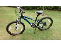 """7-9 year old Childs 20"""" mountain bike. Trek mt60, Front suspension, 6 speed in very nice condition."""