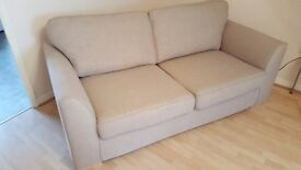 Large two seater sofa in beige fabric.