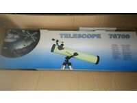 Zennox 700x76 telescope still in box never used, as new, box only opened to check contents.