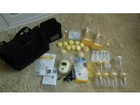 Medela freestyle breastpump with lots of extras