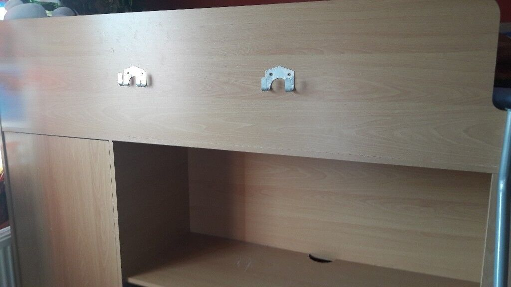 Single high bed with wardrobe desk and shelves built in