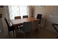 Extending Contemporary Dining Table and 6 chairs in good condition