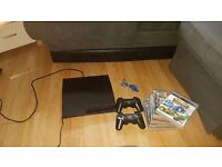 Slim playstation stack of games + 2 official controllers