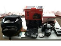 Canon EOS 1000D 10.0MP Digital SLR Camera complete kit with 2 lenses & filters with original box.