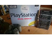Boxed playstation good condition and complete with some games.
