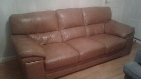 light brown leather sofa, with a few scuffs but good quality and condition.