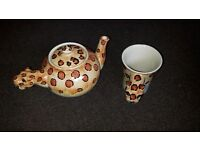 Matching teapot and cup
