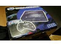 Sega Saturn in box 2 controllers with papers