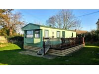 Great starter caravan for sale at the Village holiday park nr New Quay inc deck + 2018 fees