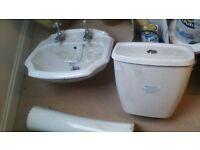 bathroom sink and cistern