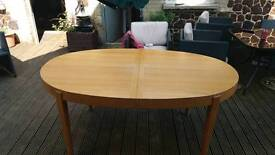 Extending Dining table seats 6-10