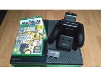 xbox one 500gb, controller, charge station, 2 games. few scratches on-top otherwise good condition