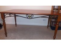 Dining table with ironwork detail.