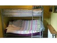 Triple bunk bed with both mattress