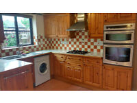 Pine kitchen units, stainless steel sink, gas hob, extractor fan and integrated oven.