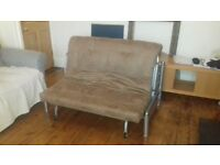 Sofa bed. Painted metal frame. Brown suede (I think it's suede) mattress