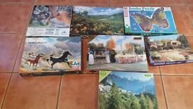 Seven 1000 piece jigsaws. All in good condition in the original boxes
