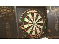 Dart board in wooden case only used a few times