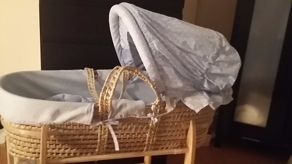 Blue and white stars moses basket with claire de lune stand and mothercare fitted jersey sheets