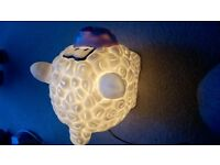 CHILDRENS NOVELTY BEDSIDE LAMP IN SHAPE OF A SHEEP.
