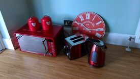 microwave kettle toaster wall clock tea and sugar containers red