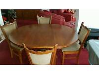 Antique oak round extending pedestal table and four chairs