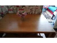 Solid pine extending dining table with four rattan chairs