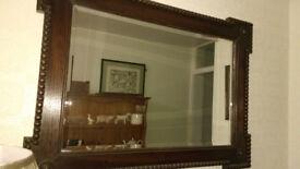 Dark wood antique mirror