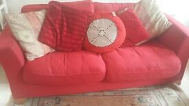 free for collection from Bickley red linen 2 seater sofa good condition