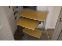 BEECH EFFECT DESK/TABLE WITH PULL OUT SHELF, ON CASTERS, VGC