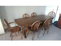 Large Solid Wood Dining Room Table with 6 matching wood chairs- delivery possible