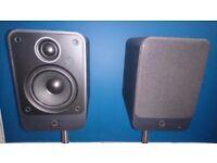 Q Acoustic bookshelf speakers.