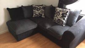 Black / charcoal material corner sofa