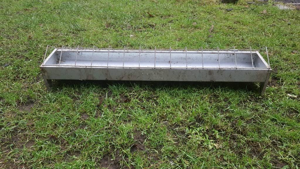 galvanized chicken feeder trough.