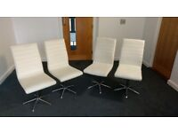 FOUR DWELL FAUX CREAM LEATHER SWIVEL DINING CHAIRS - USED .