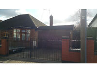 This detached two bedroom bungalow sits on a large site with huge development potential.