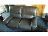 Two seater dark brown, part leather reclineable sofa