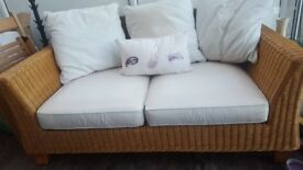 2 seater sofa wicker and cream cushions