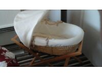 Mamas and papas moses basket with stand and bedding. Hardly used.